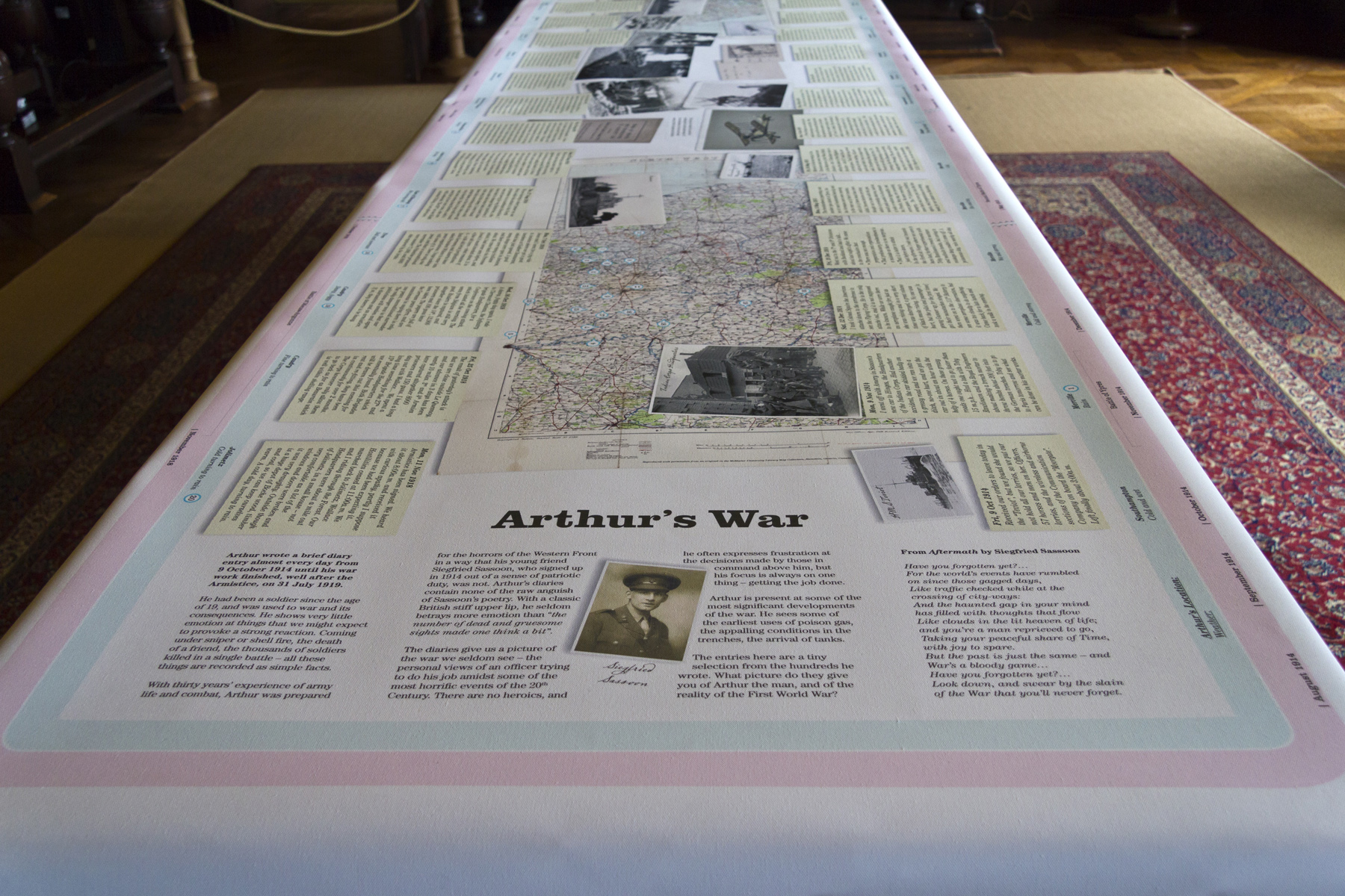 "A unique way to display information - our printed ""tablecloth"" in the dining room features a timeline of World War I."